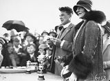 Picture of / about 'Manuka' the Australian Capital Territory - Reverend Doctor William John Edwards, Headmaster of Canberra Grammar School with Lady Stonehaven, wife of the Govenor General with trophies for the School Sports Day at Manuka Oval.