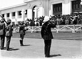 Picture relating to Parliament House - titled 'Armistice Day, Old Parliament House front steps with RMC [Royal Military College] Cadets and spectators, bugler sounding the Last Post.'