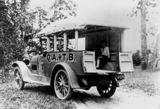 Picture relating to Queensland - titled 'Boy sitting in the back of an ambulance, 1920-1930'