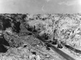 Picture of / about 'Moura' Queensland - Dredgers and trucks in the opencut mine at Moura, Queensland, 1962