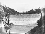 Picture relating to Cotter Dam - titled 'Cotter Dam wall, spillway and stilling pond.'