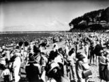 Picture relating to Sandgate - titled 'Crowds on the beach at Sandgate, Brisbane, ca. 1935'