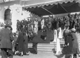 Picture relating to Parliament House - titled 'Royal Visit, May 1927 - Canberra citizens passing the Royal Party on the front steps on Old Parliament House at the Civic Reception.'