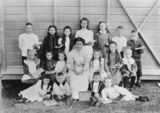 Picture relating to Kerry - titled 'Schoolchildren and their teacher on Prize Day, Kerry School, 1909'
