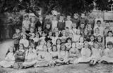 Picture relating to Bowen Bridge Road - titled 'Portrait of school children from the Bowen Bridge Road State School, Windsor, Brisbane, ca.1910'