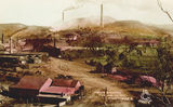 Picture relating to Mount Morgan - titled 'Elevated view of the Mount Morgan mine, ca. 1910'