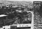 Picture relating to Brisbane - titled 'Fortitude Valley and surrounds seen from atop the Story Bridge during construction, Brisbane, ca. 1938'
