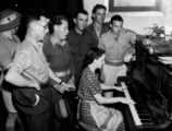 Picture relating to Queensland - titled 'Soldiers enjoying a sing song around the piano, 1939-1945'