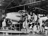 Picture relating to Archerfield - titled 'Aircraft mechanics working on an Avro Anson Mk1 plane, Archerfield, ca. 1942'