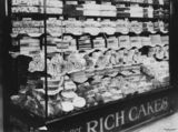 Picture relating to Brisbane - titled 'Front display window of G. E. Adams' cake shop, Brisbane Arcade, Brisbane, ca, 1938'
