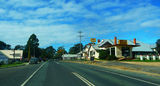 Picture relating to Bodalla - titled 'Princes Highway through Bodalla with Bodalla Arms Hotel on the left'