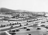 Picture relating to Canberra - titled 'Hotel Canberra, Commonwealth Avenue and Albert Hall from West block showing young trees and road system.'