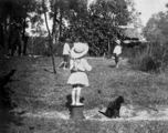 Picture relating to Queensland - titled 'Children playing in a backyard'