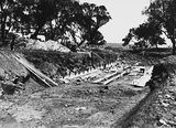 Picture relating to Campbell - titled 'Drainage culvert, under construction on Duntroon Road now Fairbairn Avenue, Campbell.'