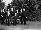 Picture relating to Yarralumla - titled 'Executive Council at Government House, Yarralumla. Seated, Prime Minister Joe Lyons and Governor General Sir Isaac Isaacs, Standing includes Archdale Parkhill, Bracegirdle, Finlay, Starling.'