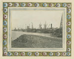 Picture relating to Townsville - titled 'Ships at the wharf in Townsville, surrounded by a hand illustrated frame, 1913'