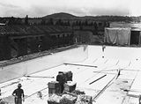 Picture of / about 'Manuka' the Australian Capital Territory - Manuka swimming pool under construction, tiling of the floor, Manuka Circle, Kingston.