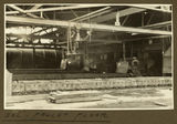 Picture relating to Mount Isa - titled 'Pallet floor inside the smelter, Mt. Isa Mines, 1932'