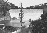 Picture relating to Cotter Dam - titled 'Cotter Dam wall spillway and stilling pond'