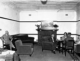 Picture relating to Barton - titled 'Brassey House, sitting room with card players, Macquarie Street, Barton.'