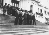 Picture relating to Scullin - titled 'Anzac Day 1933, Prime Minister Hon J. A. Lyons, Leader of the Opposition, Hon J. A. Scullin and members on front steps of Old Parliament House.'