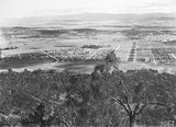 Picture relating to Braddon - titled 'View from Mt Ainslie over Ainslie Avenue including Reid, Braddon and Civic Centre etc, Ainslie Hotel and Gorman House, Reid to the right.'