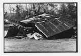 Picture relating to Innisfail - titled 'Building wrecked during Cyclone Larry, Bruce Highway near Innisfail, April 2006'