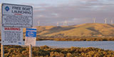 Picture relating to Toora - titled 'Toora wind farm as seen from the boat ramp'