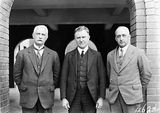 Picture relating to Page - titled 'Dr Earle Page MHR, Commonwealth Treasurer with Mr. James Thomas Heathershaw, Secretary of The Treasury (left) and Sir Henry Sheehan, Assistant Secretary of The Treasury (right).'