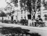 Picture relating to Brisbane - titled 'Team of drays loaded with piping outside the iron foundry in Alice Street, Brisbane'