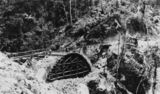 Picture relating to Mount Spec - titled 'Masonry arch bridge under construction, Mount Spec, Queensland, ca. 1933'