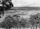 Picture relating to Kingston - titled 'View from Red Hill over Manuka and Kingston to Duntroon. Collins Park in front.'