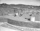 Picture relating to Weston Creek - titled 'Weston Creek Sewerage Treatment Works - Trickling filters being filled with screenings'