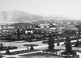 Picture relating to Canberra - titled 'Hotel Canberra and Commonwealth Avenue from West Block, Black Mountain at the rear.'