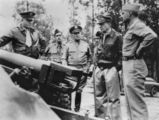Picture relating to Strathpine - titled 'General MacArthur inspecting the artillery gun at Strathpine, Queensland, 1939-1945'