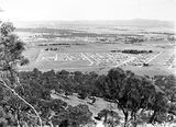 Picture relating to Ainslie - titled 'View from Mt. Ainslie looking towards St John's church and Reid, Canberra.'