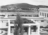 Picture relating to Black Mountain - titled 'View to west from Old Parliament House courtyard. Hotel Canberra and Albert Hall in centre, Black Mountain in background.'
