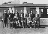Picture relating to Garran - titled 'Presentation of Charter of Rotary Club, group photo [Sir Robert Garran, Sir John Butters and CS Daley can be identified] in front of Hotel Canberra.'
