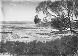 Picture relating to Ainslie - titled 'Braddon and Civic Centre from Mt Ainslie. Ainslie Hotel, Limestone Avenue in foreground.'