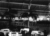 Picture relating to Brisbane - titled 'Tables and chairs set up in the woolstore at New Farm, Brisbane, for the Vice-regal ball held in honour of the visiting Duke and Duchess of York, 1927'
